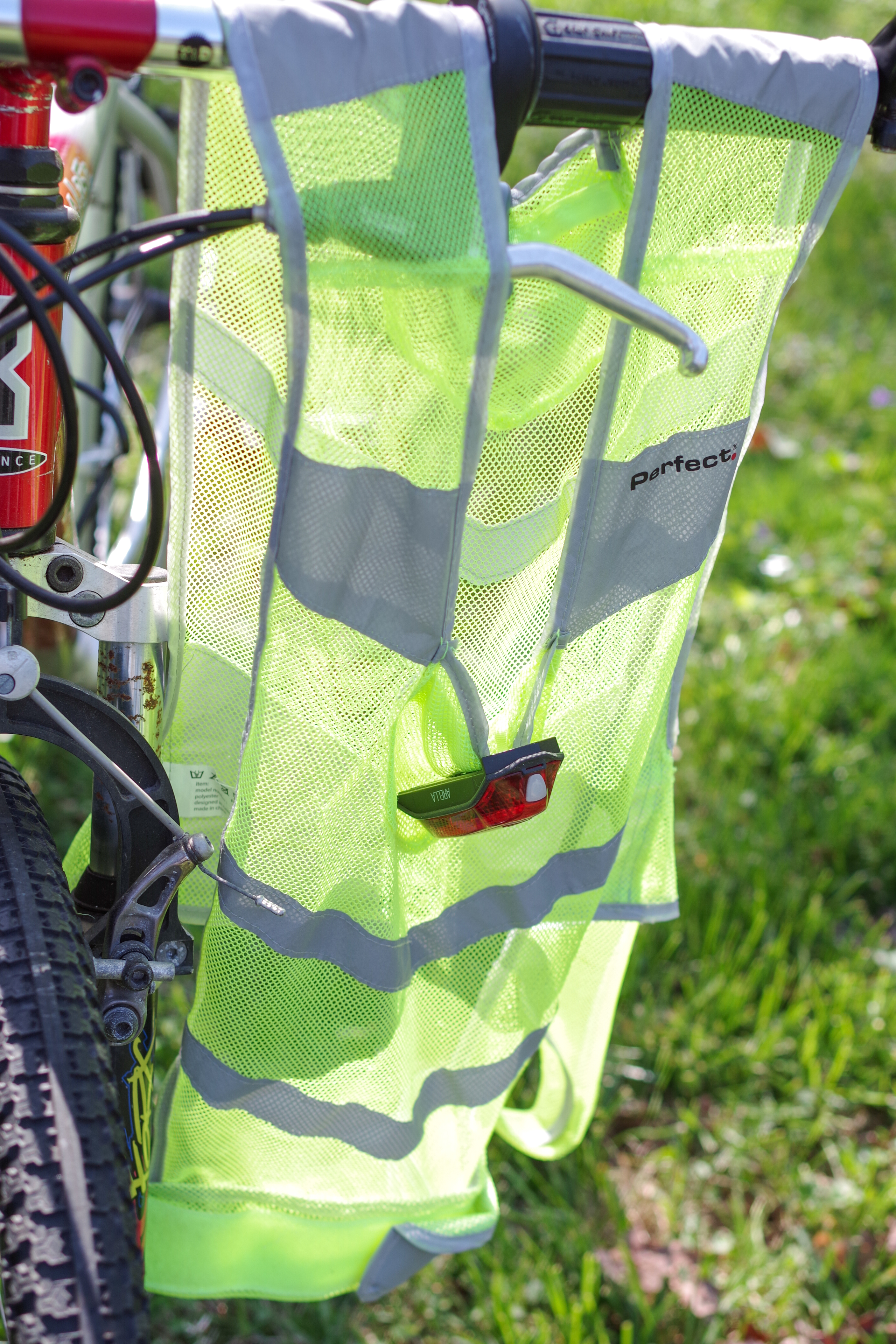 Reflective bicycling safety vests with detachable lights can improve the visibility of the bicyclist to motor vehicles as well as to pedestrians. This particular vest is available for rent through Jill + Ian's Bicycle Rentals. Photo © Jillian Regan 2018