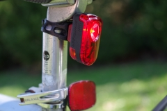 A red, rechargeable, battery operated tail light that can be attached to a bicycle's seat post is another way to improve visibility of the bicyclist to motor vehicles, other bicyclists, and pedestrian. This tail light is available for rent in Charlottesville, VA through Jill + Ian's Bicycle Rentals. Photo © Jillian Regan 2018